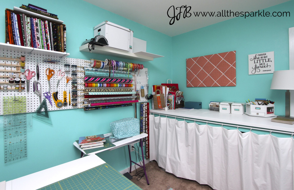 Teal, coral, and white craft room www.allthesparkle.com